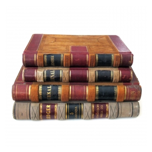 a large and unique set of 4 leather-bound accounting ledgers with gilt highlights