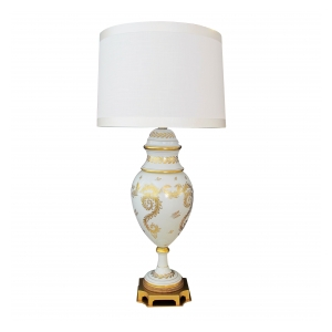 an elegant and good quality american 1950's blanc de chine porcelain lamp with gilt decoration; labeled 'Marbro Lamp Co., Los Angeles'