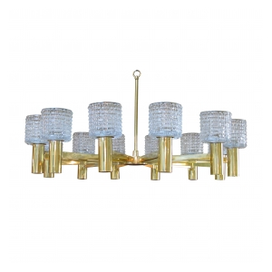 a stylish and large-scale italian 1960's brass 12-arm chandelier with Orrefors crystal shades; by Arredoluce Monza