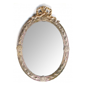 a handsome and large-scaled continental neoclassical style silver repousse oval mirror