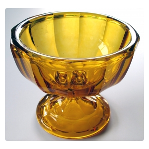 a heavy and thickly-modeled bohemian mid-century pedestal bowl of honey-colored glass; by moser glassworks