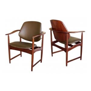 a mod pair of danish arne hovman-olsen 1960's teak armchairs with leather upholstery