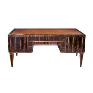 handsome and boldly-scaled french art deco macassar-veneered pedestal desk