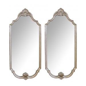 a good pair of american mid-century Hollywood Regency ivory painted and silver-giltwood pier mirrors by Widdicomb