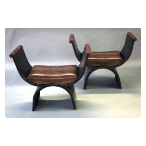 unique and boldly-scaled french industrial iron curule-form benches with faux alligator leather seats