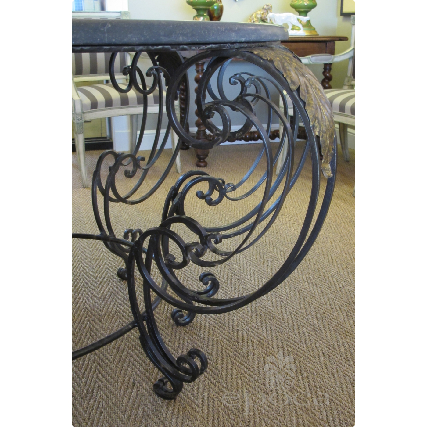 a curvaceous french rococo style wrought iron circular center