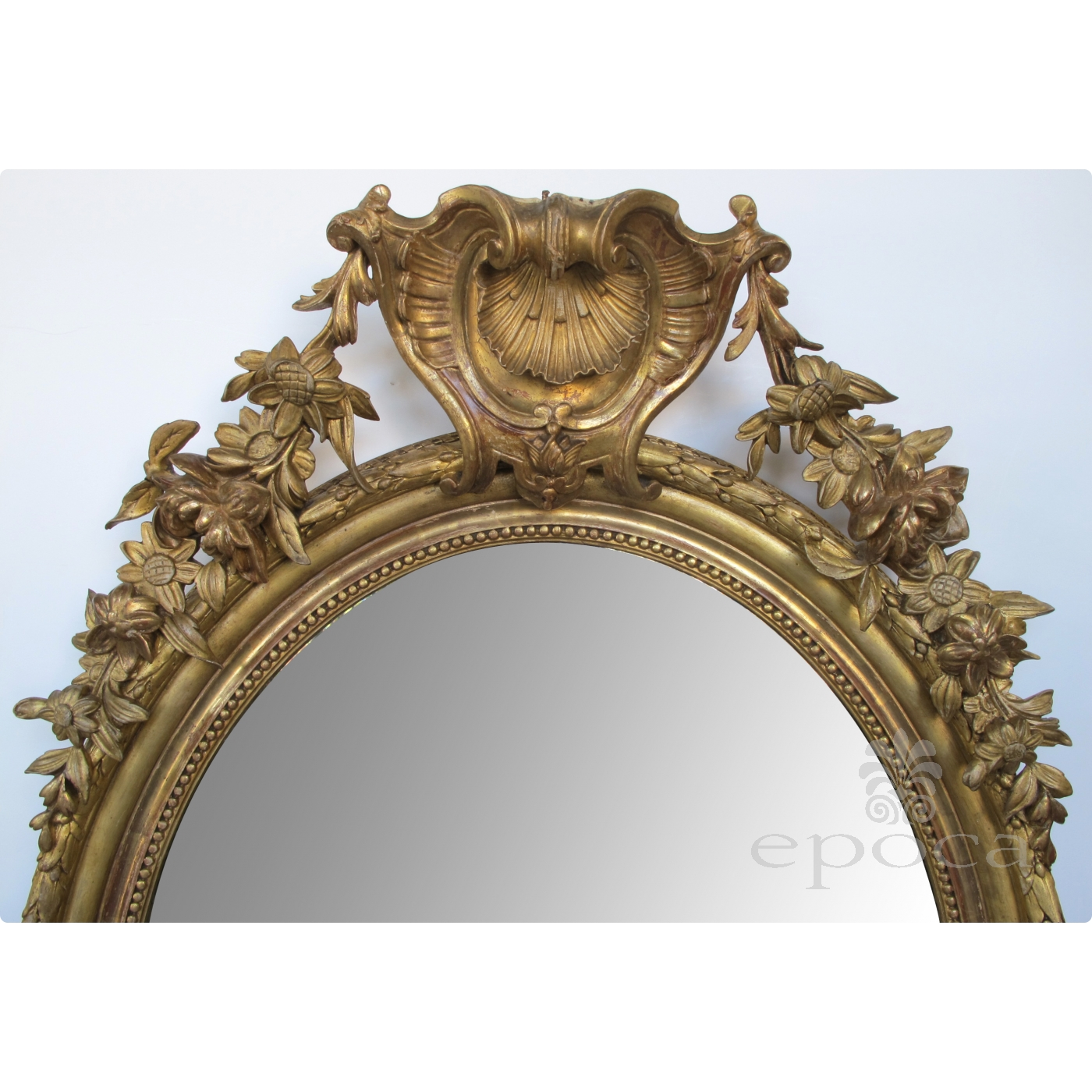 A Finely carved French Napoleon III Oval Giltwood Mirror