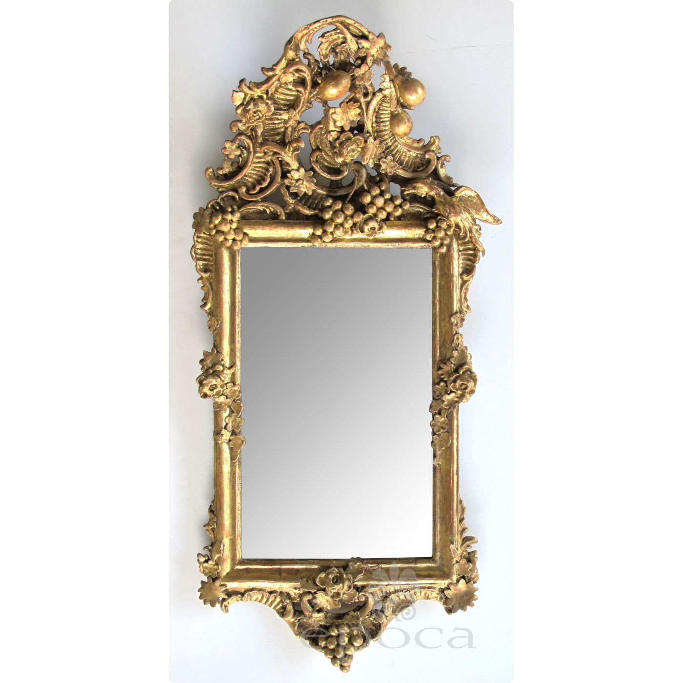 An Ornately Carved French Rococo Gilt Wood Mirror With