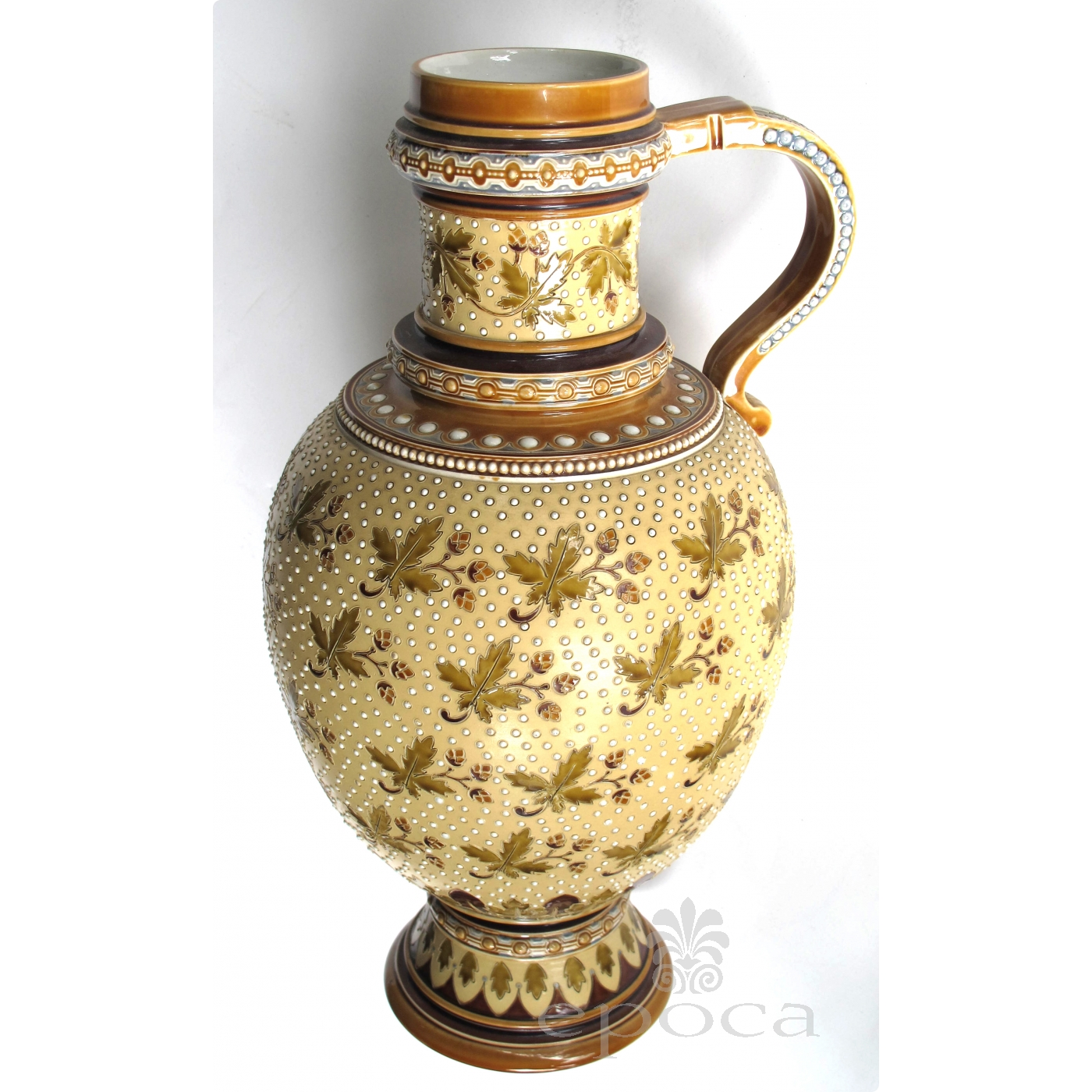 A Good Quality Pair Of German Mettlach Pottery Ewers Each