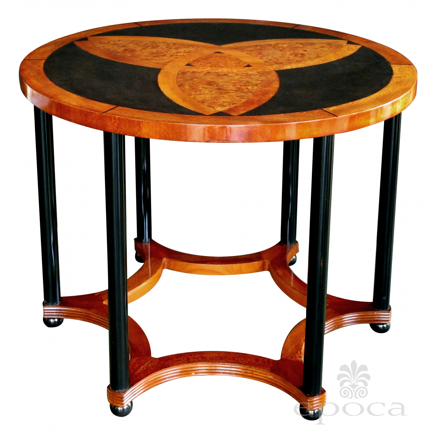 a sophisticated austrian art deco amboyna inlaid circular table
