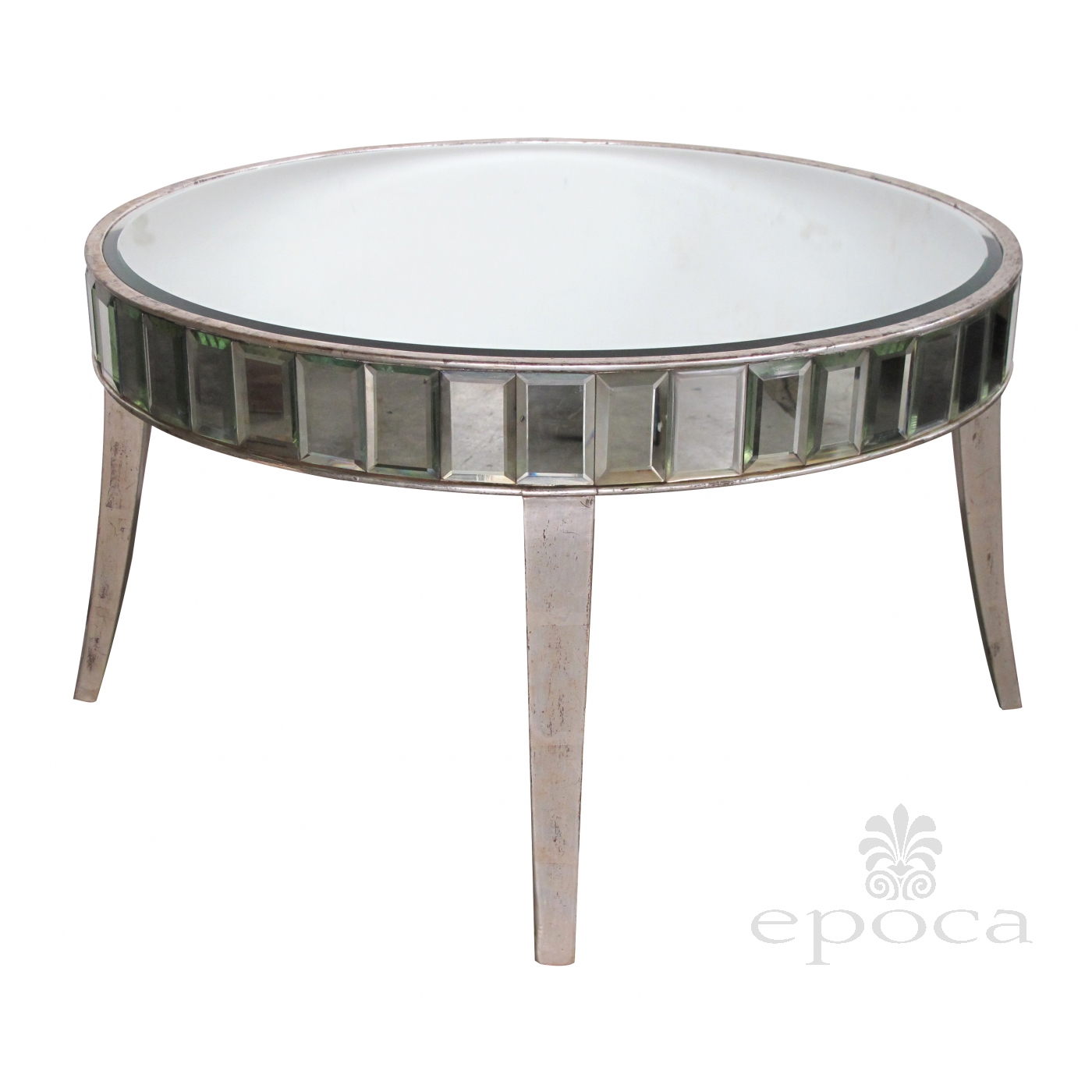 a shimmering american mid century circular mirrored coffee