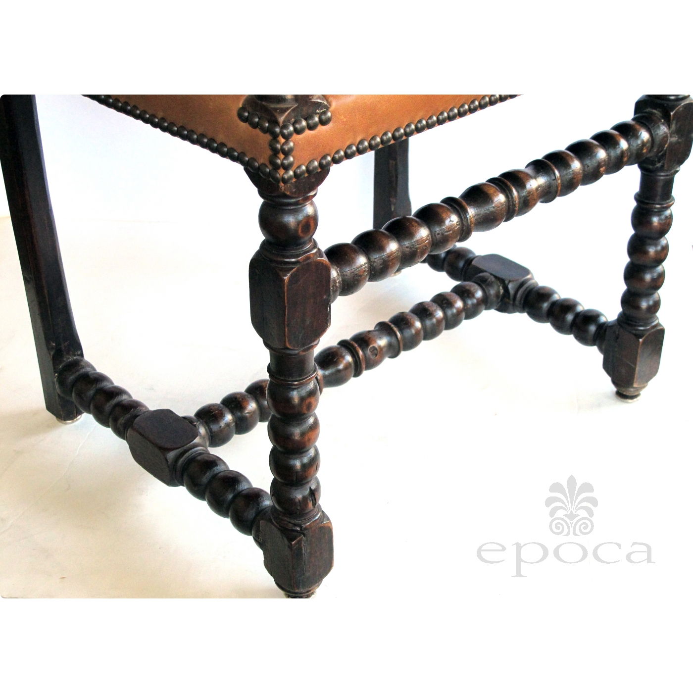 a handsome english baroque style carved oak bobbin chair with