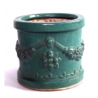pair of malaysian teal-glazed terracotta planters with raised floral garland