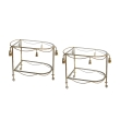 a chic pair of italian mid-century hollywood regency gilt tole drinks/bar carts with glass shelves
