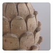 a robust pair of mexican hand-carved cantera stone artichoke elements