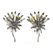 a stylish pair of american art deco tole and brass foliate-form sconces centering glass spheres
