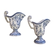 a good pair of french blue and white tin-glazed faience pitchers or ewers; probably Rouen