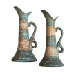 a rare pair of german arts and crafts matte glazed pottery pitchers; incised 'Colmin' stamped 'Germany'