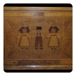 charming Alsatian folk art wooden mosaic panel depicting 3 children holding hands; now mounted as a table; dated 1933
