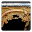 a curvaceous and finely carved french regence giltwood console table with grape vine motif and sage green marble top