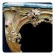 a curvaceous and finely carved french regence giltwood console Tables with grape vine motif and sage green marble top