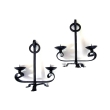 a handsome pair of english arts and crafts wrought iron 2-arm tripod candelabras