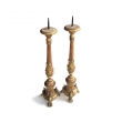 a good quality and large pair of italian baroque style giltwood tripod pricket sticks