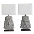 a well-carved and stylized pair of italian romanesque style gray painted wooden masks now mounted as lamps