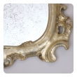 a shapely and elegant pair of italian rococo style silver-leafed giltwood cartouche-form mirrors