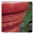 a handsome english burmantofts 19th century iron-red glazed fluted column pedestal; stamped 'Burmantofts Faience, England'