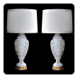 an elegant pair of american frederick cooper 1960's white-glazed baluster-form lamps with raised floral decoration