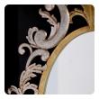 a chic italian 1960's gilt-tole hollywood regency oval wall mirror