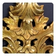 an exuberant italian rococo revival carved giltwood mirror