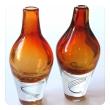 exceptional pair of Kosta Boda Swedish orange art glass vases; designed by Klas-Goran Tinback