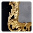 elegant and superbly-carved english george II giltwood mirror with elaborate foliate crest