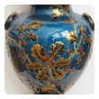 large and exquisitely rendered english teal-glazed ceramic urn with raised oak branchwork decoration