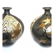 a large and striking pair of asian-inspired 1960's ceramic vases adorned with stylized birds