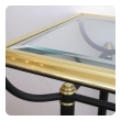 a good quality french 1950's brass and black metal console table with beveled glass top and lower shelf