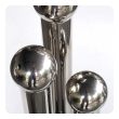 a cleverly-designed set of french mid-century chrome fire tools in tubular recepticles