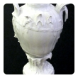 finely rendered pair of french rococo style blanc-de-chine urns/vases