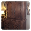 an impressive french provincial walnut buffet-a-deux-corps/cabinet