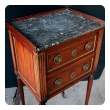 a charming french directoire 2-drawer walnut commode with brass detailing