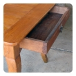 a handsome, rustic and sturdy french country cherry wood farm table with drawer and slide