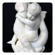 an expressive and well-carved italian rococo revival carrara marble niche fountain of a putti seated on a dolphin