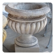 A Large-scaled French Neoclassical Carved Limestone Gadrooned Urns