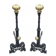 a large and stately pair of spanish tudor-style hand-wrought iron andirons with brass elements