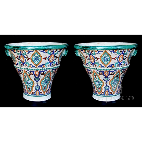 a large and vibrantly glazed pair of Moroccan conical-form double-handled pot