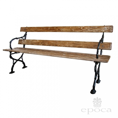 a long and well-crafted french art nouveau pine garden bench with faux bois ironwork