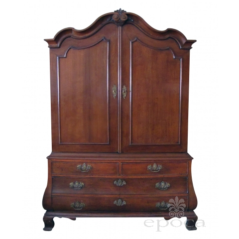 a handsome and warmly-patinated dutch rococo bombe-form carved oak two-door cabinet