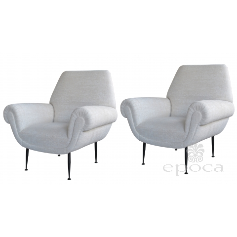 a stylish pair of italian mid-century club chairs with ebonized metal legs by Gigi Radice for Minotti, Milan